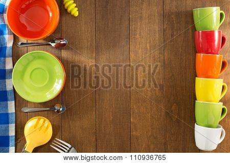 dishes set on wooden background