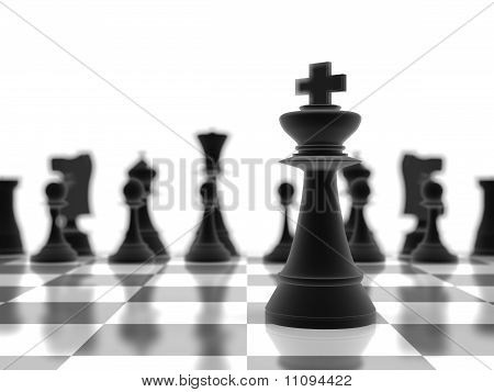 The King Chess Piece Standing Infront Of The Rest Of The Pieces