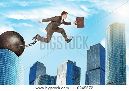 Man with iron ballast hopping over city