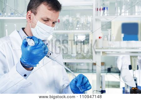 Male Researcher At His Workplace In The Laboratory.