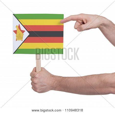 Hand Holding Small Card - Flag Of Zimbabwe