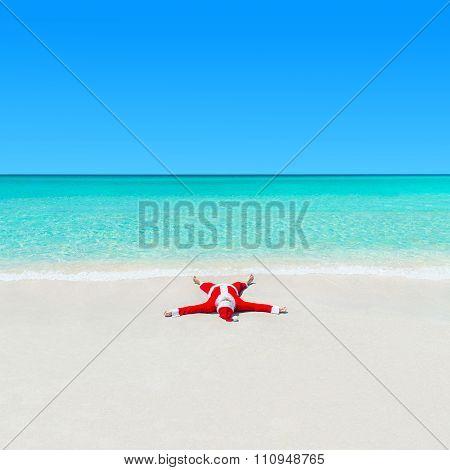Christmas Santa Claus Sunbathing On Sand At Tropical Ocean Beach