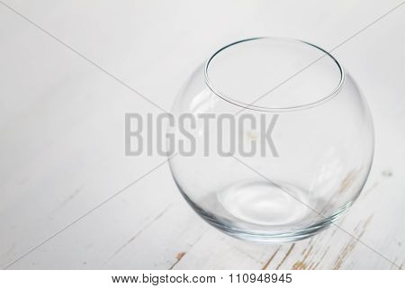 empty glass bowl on white wood background