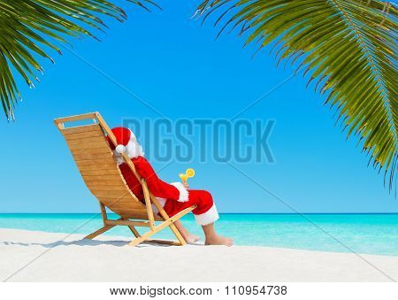 Christmas Santa Claus With Cocktail On Deckchair At Tropical Beach