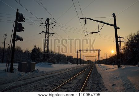 Winter railway at sunset