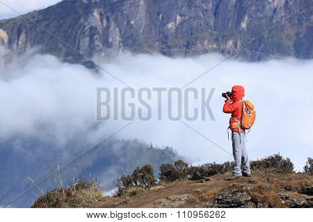 one young woman hiker hiking on mountain peak