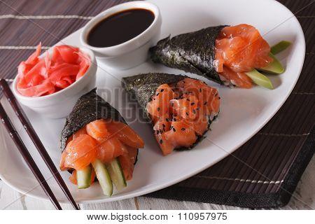 Japanese Cuisine: Salmon Temaki Sushi On A Plate Close Up. Horizontal