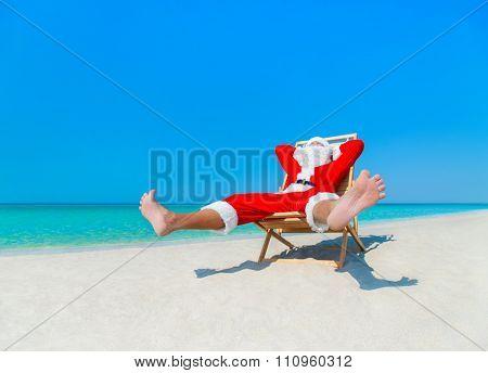 Christmas Santa Claus Sunbathe On Sunlounger At Ocean Sandy Tropical Beach