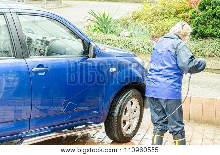 Woman Cleans The Family Car Manually