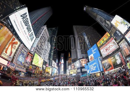 Fisheye lens photo of Times Squares crowded with tourists at night.