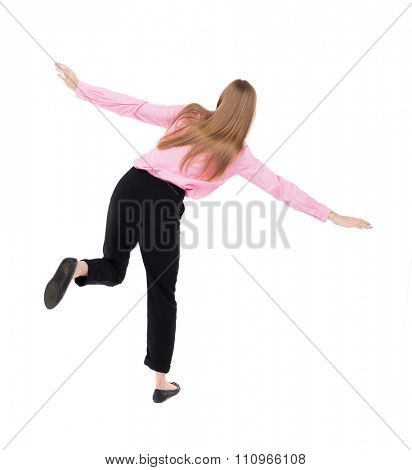 Balancing young business woman.  or dodge falling woman. Rear view people collection.  backside view of person.  Isolated over white background. girl office worker in black trousers jumping on one leg