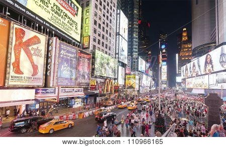 Times Squares crowded with tourists at night .
