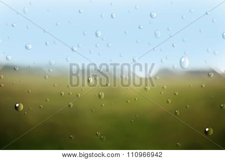 Nature through window with rain drops.
