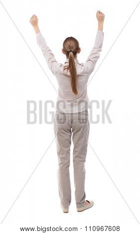 Back view of  business woman.  Raised his fist up in victory sign.    Raised his fist up in victory sign.  Rear view people collection.  backside view of person.