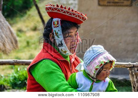 Quechua Mother And Baby In A Village In The Andes, Ollantaytambo, Peru