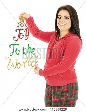 A beautiful teen girl in her Christmas pajamas holding a sparkly