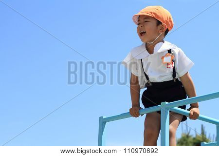 Japanese kindergarten child on the jungle gym (4 years old)