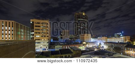 Panoramic rooftop shot of city skyline of Raleigh, North Carolina at night