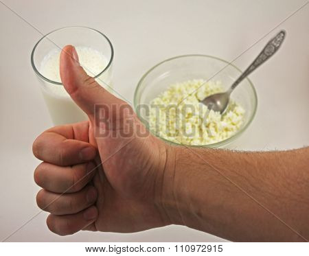Thumbs Up Man's Hand On The Background Of Cottage Cheese And Kefir