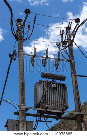 poles with transformers on a background of blue sky