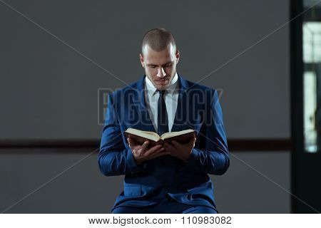 Muslim Businessman Reading Holy Islamic Book Koran