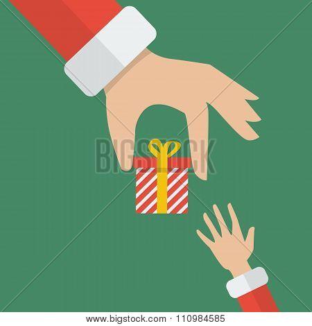 Santa Hand Giving A Gift Box To Kid