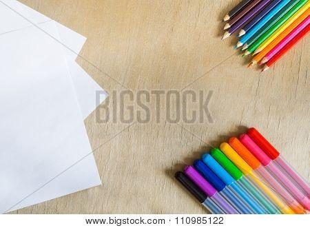 Felt-tip Pens, Pencils On Wooden Background