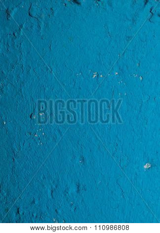 Detail of concrete wall painted in blue color in sunlight