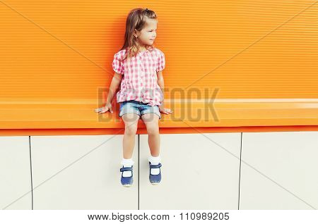 Fashion Little Girl Child Wearing A Sunglasses And Checkered Shirt Over Colorful Background