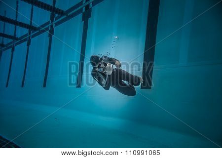 Dynamic No Fins Freediver Doing A Turn During Performance From Underwater