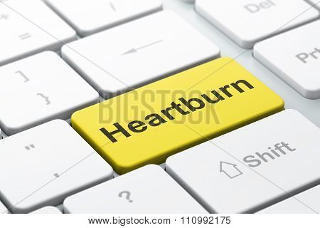 Health concept: Heartburn on computer keyboard background