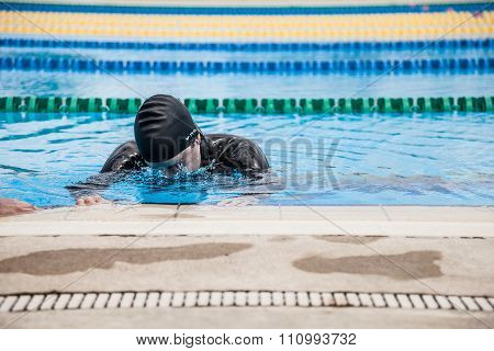 Competitor Getting Ready By Doing A Wet Warm-up