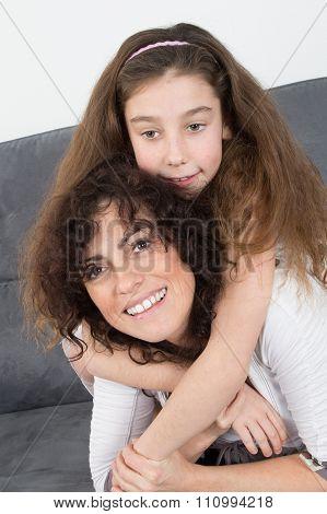 Loving Mother Giving Daughter Piggy Back Ride