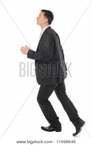 Businessman runs up the career ladder