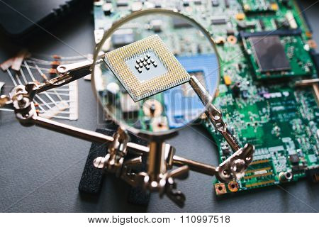 Cpu Processor Through A Magnifying Glass.