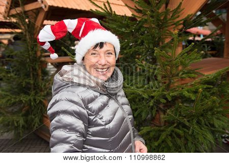 Attractive Woman With Cristmas Hat On The Christmas Market