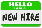 Постер, плакат: Hello I Am a New Hire words written on a green nametag sticker for a rookie employee or fresh talent