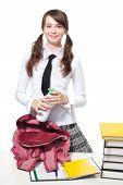 foto of teen pony tail  - Happy teen Girl with bottle of yogurt in school and backpack - JPG
