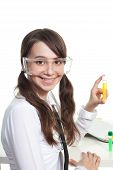 picture of teen pony tail  - Happy teenager study chemistry holding a test tube and smiling - JPG