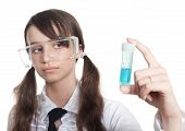 stock photo of teen pony tail  - clever teenage girl study biology looking at test tube - JPG
