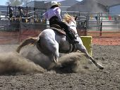 image of barrel racing  - a cowgirl competing in the barrel race - JPG