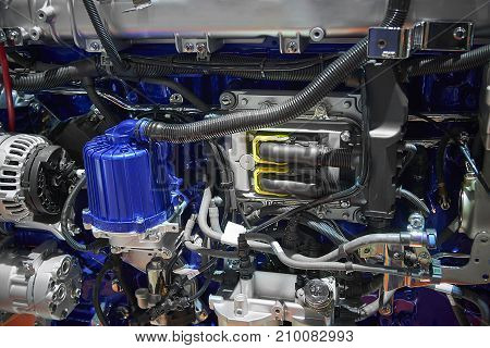 poster of Close up new truck diesel engine motor with different parts details. Truck engine motor filter alternator electronic electric parts. Abstract modern auto automotive industrial background pattern