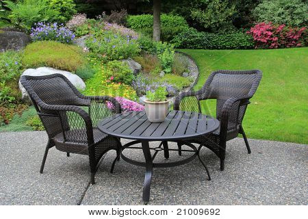Patio furniture in a beautiful garden.