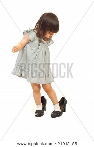 Toddler Girl With Big Shoes