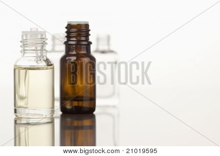 Focus on two glass phials against a white background