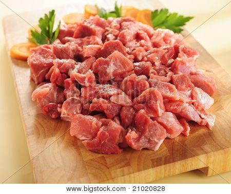 Raw Beef Stew. Arrangement On A Cutting Board.