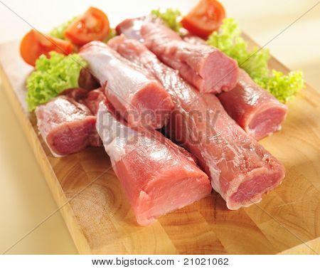 Pork Tenderloin. Arrangement On A Cutting Board.