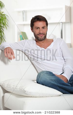 Man sat on sofa