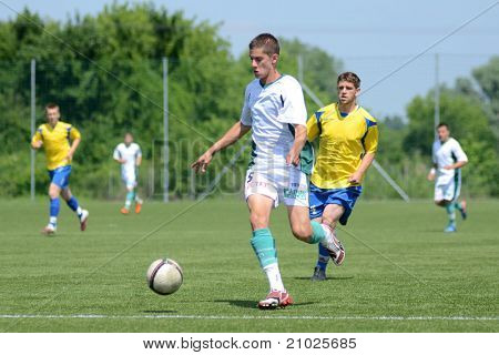 KAPOSVAR, HUNGARY - JUNE 11: Viktor Szepesi (in white) in action at the Hungarian National Championship under 13 game between Kaposvari Rakoczi FC and Bajai LSE on June 11, 2011 in Kaposvar, Hungary.