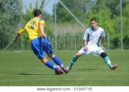 KAPOSVAR, HUNGARY - JUNE 11: Erik Judak (in yellow) in action at the Hungarian National Championship under 19 game between Kaposvari Rakoczi FC and Bajai LSE on June 11, 2011 in Kaposvar, Hungary.